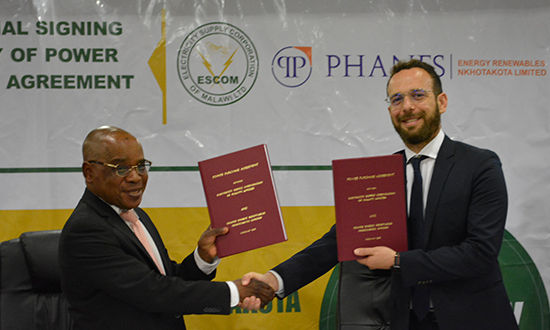 DONE DEAL! ESCOM CEO, Dr. Allexon Chiwaya and  Phanes Energy Renewables Nkhotakota Limited Head of projects, Mr Alessandro Ortu, shake hands after signing the Power Purchase Agreement.